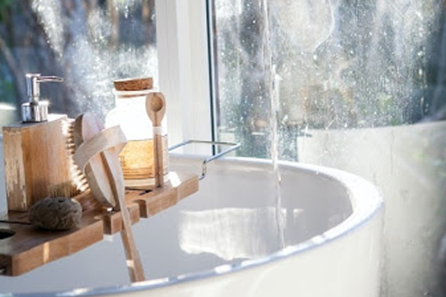 A bathtub with water running from the faucet