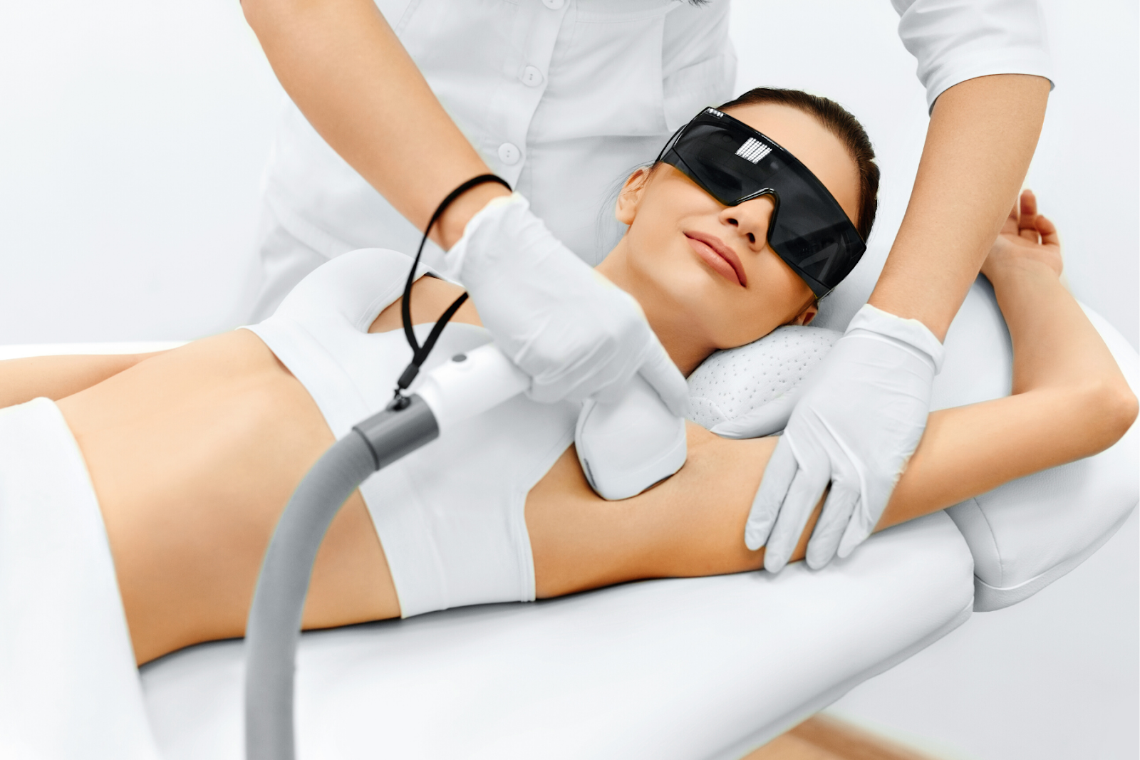 A woman receiving laser hair removal in Toronto on her armpits
