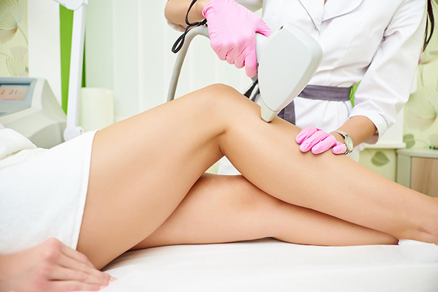 : A laser hair removal specialist treating a patient
