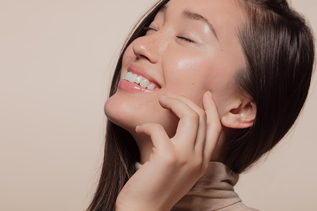 A woman with beautiful and youthful looking skin from Fractora