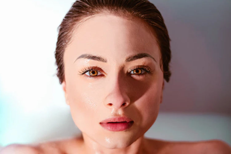 Close up of a woman in a tub of water