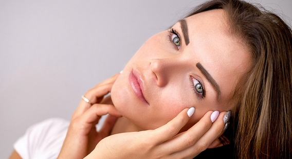 Girl caressing her soft facial skin