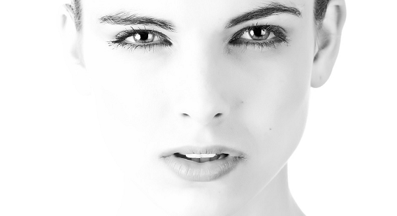 Close up picture of a woman in black and white.